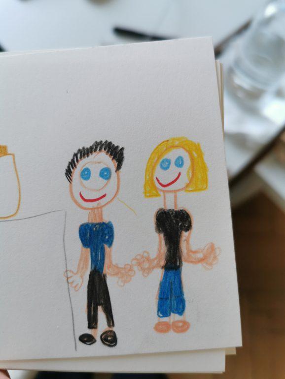 Eine selbstgemalte Postkarte mit zwei Personen