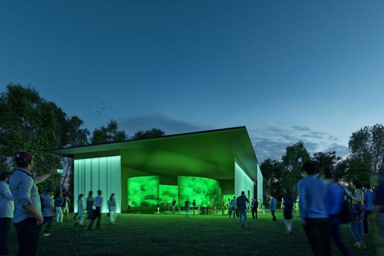 Der mobile Pavillon der STEIERMARK SCHAU (der Ersatz für die Landesausstellung)leuchtet grün in der Dämmerung.